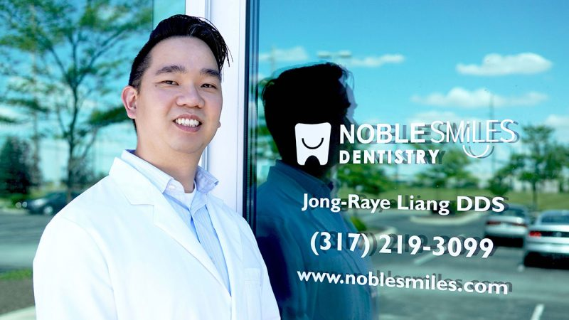 Photo of dr jr liang, a dentist noblesville in, standing in front of his office